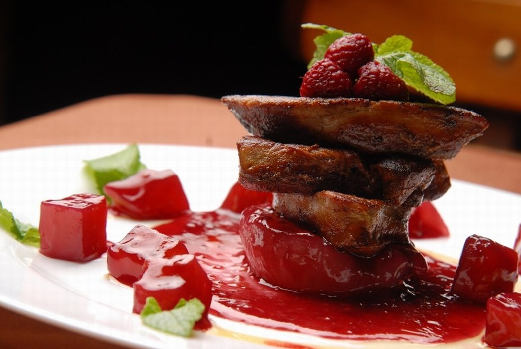Roasted goose liver with raspberry sauce and fresh raspberries